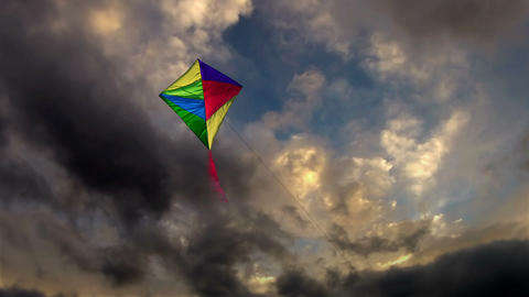 Kite Flying In The Cloudy Dark Sky stock footage