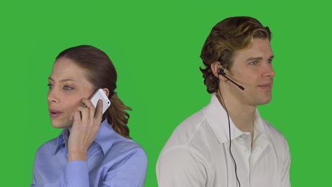 Male customer service speaks with woman (Green Key) ビデオ