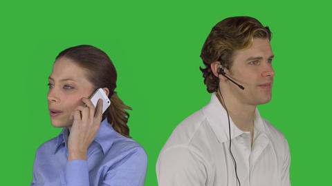 Male customer service speaks with woman (Green Key) Footage