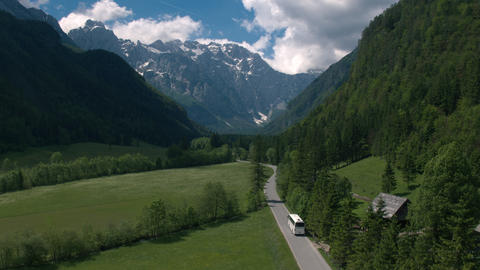 Aerial - Tracking shot of a bus driving through the famous Logar valley Footage