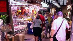 people walking in market la Boqueria in Barcelona, Spain Footage