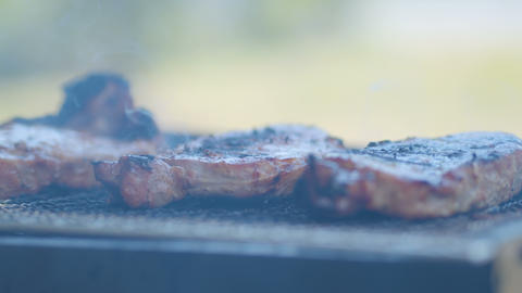 BBQ beef on the grill with smoke, outdoor Live Action
