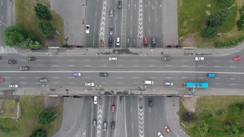 Aerial Drone flight over the highway. Vertical shot. Car traffic. Highway Live Action