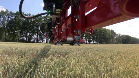 View from the tip of an arm of self propelled sprayer on a wheat field Live Action