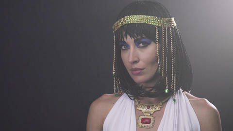 The look of Cleopatra, young queen with blue makeup is looking at the camera Live Action