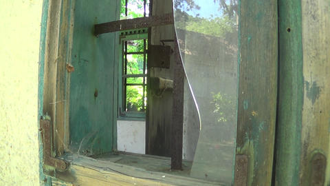 Old and abandoned house broken glass on window Live Action