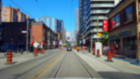 Driving Downtown City Street With Blur Effect. Driver Point of View POV of Urban Road With Tall Footage