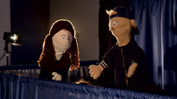 Puppet theater: boy and girl speaking with each other Footage