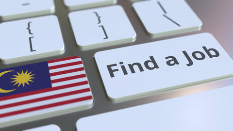 FIND A JOB text and flag of Malaysia on the buttons on the computer keyboard Live Action