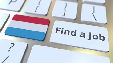 FIND A JOB text and flag of Luxembourg on the buttons on the computer keyboard Live Action
