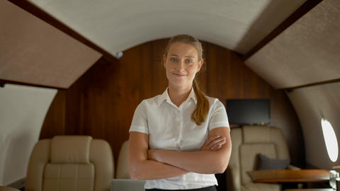 Rich businesswoman inside of luxury private business jet smiling Footage