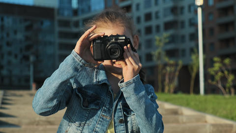 Portrait of a little girl holding a camera Footage