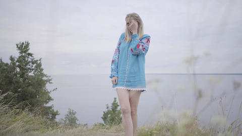 Cute carefree caucasian girl wearing long summer fashion dress looking confident Footage