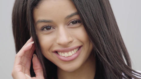 Portrait cute confident carefree African American girl looking at camera Live Action