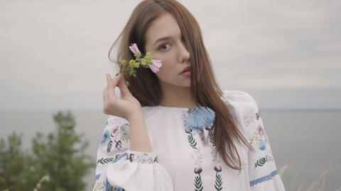 Portrait charming carefree girl wearing long summer fashion dress looking Footage