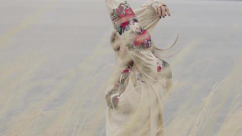 Portrait carefree caucasian girl wearing long summer fashion dress enjoying Live Action