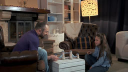 Father and daughter spending leisure time near thevfireplace in the living room Footage