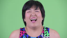 Face of happy young overweight Asian woman laughing ready to party Footage