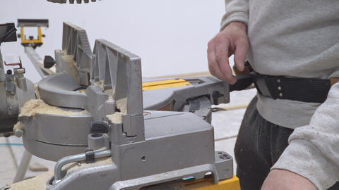 Handsome man carpenter using a circular saw while… Stock Video Footage