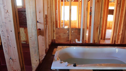 Bathroom unfinishing new home installation of plumbing, faucets, water and Live Action