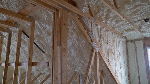 New home construction with installation of attic with foam insulation Live Action