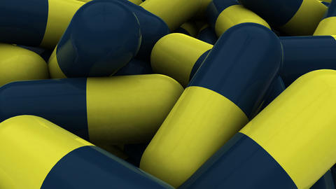 Pile of blue and yellow medication capsules Animation