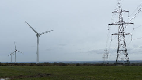 Wind Turbines and Electrical pylon towers Live Action