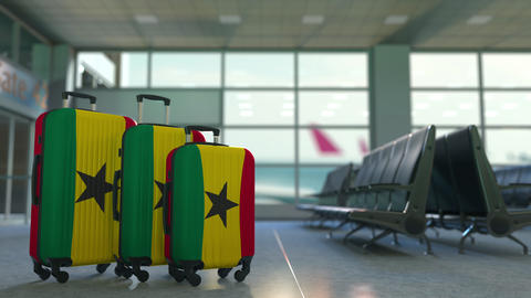 Travel suitcases with flag of Ghana. Ghanaian tourism conceptual 3D animation Live Action