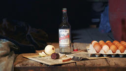 Exhibit of old peasant table with vodka, sausage, onion, eggs and other things Footage