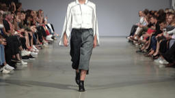 Fashion show. Male (man) model walks on the catwalk. Style Footage