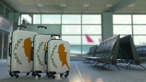 Travel suitcases with flag of Cyprus. Cypriot tourism conceptual 3D animation Live Action