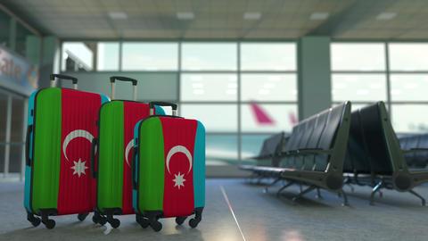 Travel suitcases with flag of Azerbaijan. Azerbaijani tourism conceptual 3D Live Action