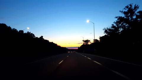 Driving Rural Countryside Highway During Sunrise. Driver Point of View POV While Sun Rises on Footage