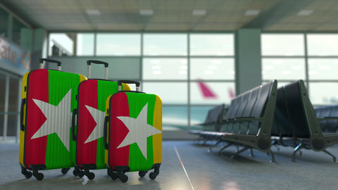 Travel suitcases with flag of Myanmar. Myanma tourism conceptual 3D animation Live Action