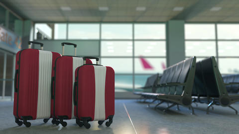 Travel suitcases with flag of Latvia. Latvian tourism conceptual 3D animation Live Action