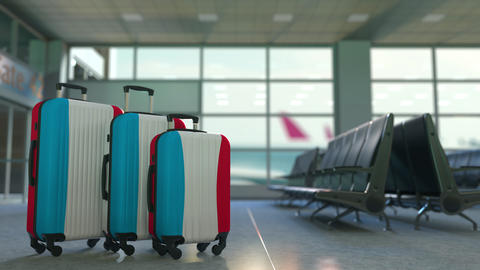 Travel suitcases with flag of Luxembourgh. Luxembourghian tourism conceptual 3D Live Action