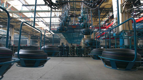 Tires production. Conveyor with tires at factory Live Action