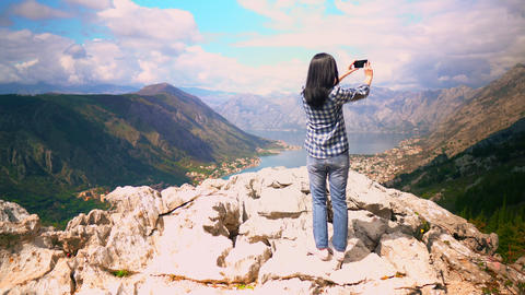 climber using smartphone shoot mountain nature landscape in summer Live Action