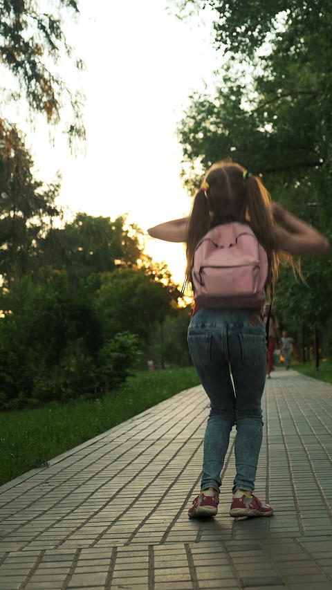 Vertical video for social networks. Schoolgirl with a backpack Footage