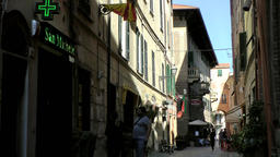 Europe Italy Liguria Albenga 013 pharmacy in shady alleyway in old district of d Footage