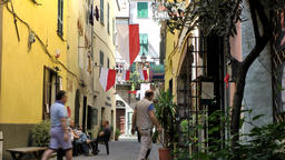 Europe Italy Liguria Albenga 015 citizens sit outside of rustic restaurant in ol Footage
