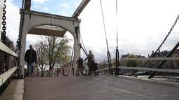people crossing channel drawbridge in amsterdam Footage