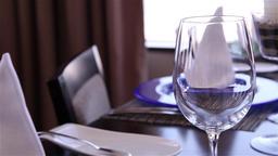 Waiter put glasses of wine on the table, slider Footage