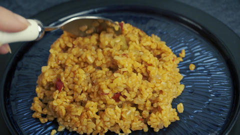 Bulgur pilaf with tomato and pepper. Vegetarian food concept. Traditional Turkish Ramadan food Live Action