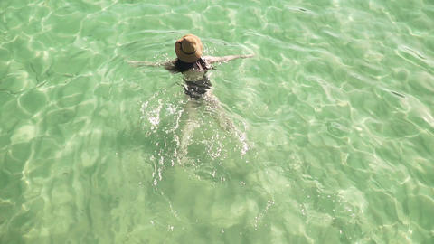 Girl swims in clear colorful transparent water Footage