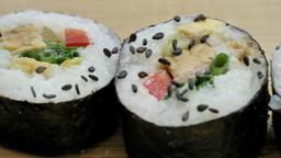 Sushi rolls on a wooden board. Slider shot Live Action