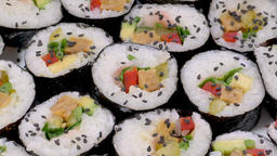Slider shot through a plate with sushi rolls Live Action