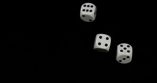 Dice rolling against Black background, slow motion 4K Stock Video Footage