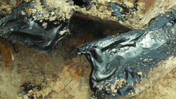 Toxic tar asphalt chemical in detail and closeup clay. Former dump waste Footage