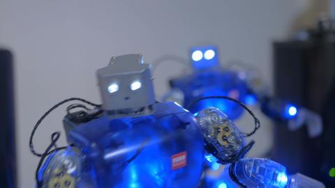 Humanoid robots dancing at robotic show Footage